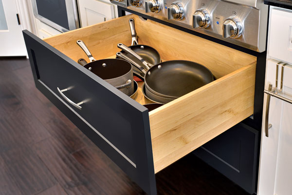 CliqStudios Dayton pots and pans cabinet in Painted Carbon storing black cookware